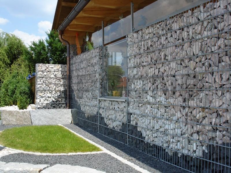 Отделка фасада натуральным камнем фото